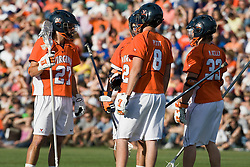 Virginia defenseman Ken Clausen (27), Goalie Bud Petit (8), defenseman Ryan Nizolek (24) and defenseman Matt Kelly (33) discuss what happened after Duke took an earliy 1-0 lead.  The #3 ranked Virginia Cavaliers fell to the #2 ranked Duke Blue Devils 19-9 at the University of Virginia's Klockner Stadium in Charlottesville, VA on April 12, 2008.