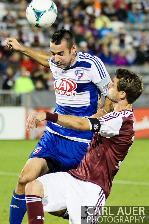 September 14th, 2013 -  FC Dallas midfielder Andrew Jacobson (4) heads the ball away from Colorado Rapids defender Drew Moor (3) in first half action of the MLS Soccer game between FC Dallas and the Colorado Rapids at Dick's Sporting Goods Park in Commerce City, CO