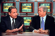 Journalists Bob Woodward (L) discusses the Monica Lewinsky scandal as Carl Bernstein looks on during NBC's Meet the Press August 9, 1998 in Washington, DC.