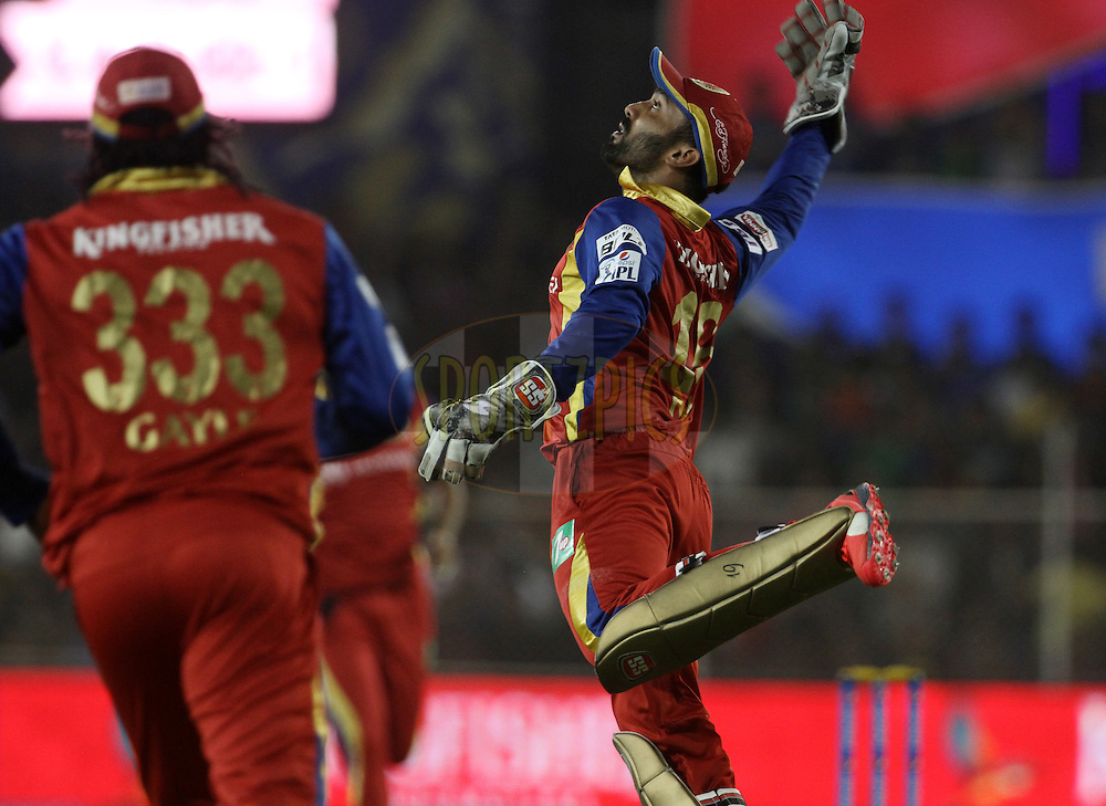 Royal Challengers Bangalore player Dinesh Karthik celebrates the wicket of Rajasthan Royals player James Faulkner during match 22 of the Pepsi IPL 2015 (Indian Premier League) between The Rajasthan Royals and The Royal Challengers Bangalore held at the Sardar Patel Stadium in Ahmedabad , India on the 24th April 2015.<br /> <br /> Photo by:  Vipin Pawar / SPORTZPICS / IPL