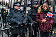 Security was unobtrusive and armed police outside Downig street were happy to pose for photos - The New Years day parade passes through central London form Piccadilly to Whitehall. London 01 Jan 2017