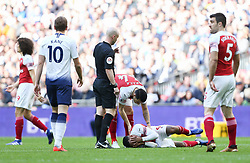 Alexandre Lacazette of Arsenal holds his face after a challenge - Mandatory by-line: Arron Gent/JMP - 02/03/2019 - FOOTBALL - Wembley Stadium - London, England - Tottenham Hotspur v Arsenal - Premier League