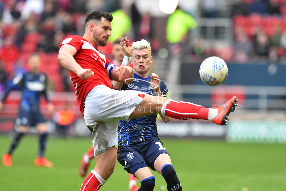 Bailey Wright (5) of Bristol City clears the ball away from Ezgjan Alioski (10) of Leeds United during the EFL Sky Bet Championship match between Bristol City and Leeds United at Ashton Gate, Bristol, England on 9 March 2019.