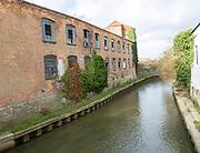 Derelict industrial buildings Innox Mills former Bowyers Works, Trowbridge, Wiltshire, England, UK - River Biss