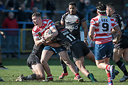 Nathan Mason (Oldham Roughyeds) is stopped by Colton Roche (Bradford Bulls) during the Kingstone Press Championship match between Oldham Roughyeds and Bradford Bulls at Bower Fold, Oldham, United Kingdom on 2 April 2017. Photo by Mark P Doherty.
