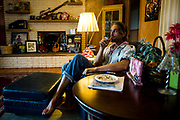 Nashville musician Todd Snider smokes a joint in his living room.  Recently Nashville has made a push to decriminalize pot laws. (The New York Times)