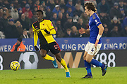 Ismaila Sarr (23) chased by Caglar Soyuncu (4) during the Premier League match between Leicester City and Watford at the King Power Stadium, Leicester, England on 4 December 2019.