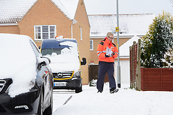 Postman Carl Disley delivers post in Jubilee Close, Cherry Willingham, Lincoln in the snow.<br /> <br /> Picture: Chris Vaughan Photography<br /> Date: February 27, 2018