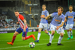April 19, 2018 - San Sebastian, Spain - Zurutuza of Real Sociedad duels for the ball with Saul Niguez of Atletico Madrid during the Spanish league football match between Real Sociedad and Atletico Madrid at the Anoeta Stadium on 19 April 2018 in San Sebastian, Spain  (Credit Image: © Jose Ignacio Unanue/NurPhoto via ZUMA Press)