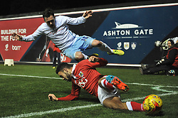 Coventry City's Danny Swanson is tackled by Bristol City's Derrick Williams - Photo mandatory by-line: Dougie Allward/JMP - Mobile: 07966 386802 - 10/12/2014 - SPORT - Football - Bristol - Ashton Gate Stadium - Bristol City v Coventry City - Johnstone's Paint Trophy