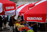 Red umbrellas with Dubrovnik written on them, local market, Dubrovnik old town, Croatia