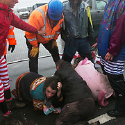 Day two of the Rolling Resistance, Preston New Road, Lancashire. Security violently try to prevent climate protectors to lock-on at the gates to Quadrilla drill site. One activists was restrained by the site manager using pressure points to the neck and throat and pinned to the ground by security staff on the road outside Quadrilla's property. Two activists managed to lock themselves down and block the gates.  A lock-on, where two or more lock themselves together inside a re-inforced tube is used as a peaceful non-violent way of blocking the gates.to the site.The New Preston Road Quadrilla site is almost ready to start drilling for shale gas after many delays caused by local objections. Lancashire County council voted against fracking but the conservative central government forced it through.