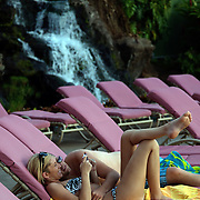 A couple get cozy for a self portrait at the Kaanapoli Beach Club in Maui, Hawaii.