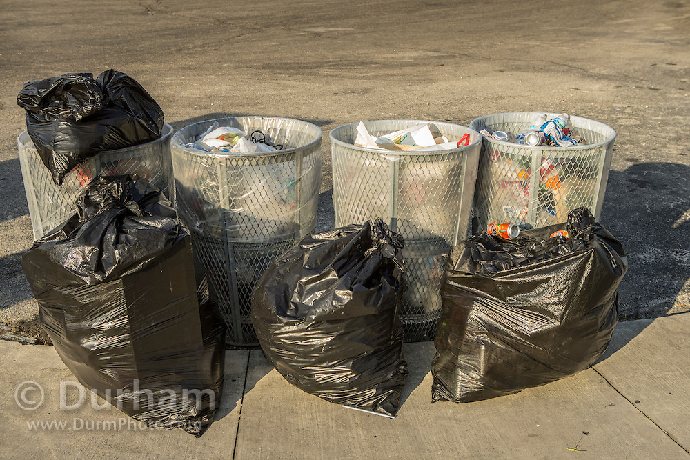 Garbage cans and bags full at Black Point Marina after a weekend.  Includes many items that could be recycled.