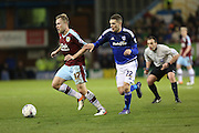 Scott Arfield of Burnley under pressure from Stuart O'Keefe of Cardiff City during the Sky Bet Championship match between Burnley and Cardiff City at Turf Moor, Burnley, England on 5 April 2016. Photo by Simon Brady.