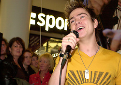 As his mum watches from behind (far left) Pop Idol Sam Nixon brings Barnsley to a stand still when he makes a personal appearance the The Mall Alahambra Shopping centre in his home town of Barnsley South Yorkshire<br />24 November 2003<br /><br />image copyright Paul David Drabble<br /><br /><br /><br />[#Beginning of Shooting Data Section]<br />Nikon D1 <br /><br />2003/11/24 16:28:46.5<br /><br />JPEG (8-bit) Fine<br /><br />Image Size:  2000 x 1312<br /><br />Color<br /><br />Lens: 17-35mm f/2.8-4<br /><br />Focal Length: 34mm<br /><br />Exposure Mode: Manual<br /><br />Metering Mode: Spot<br /><br />1/16