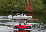 Cambridge. MA. USA. pre 2013 Head of the Charles Publicity for Mini. Red Minis racing NZL M1X Olympic Medalist Mahe DRYSDALE and Multi Silver Medalist NZL W1X Emma TWIGG on the Charles River in front of the Cambridge Boathouse.<br /> <br /> <br />  Thursday  17/10/2013 <br /> <br /> [Mandatory Credit. Peter Spurrier/Intersport Images]