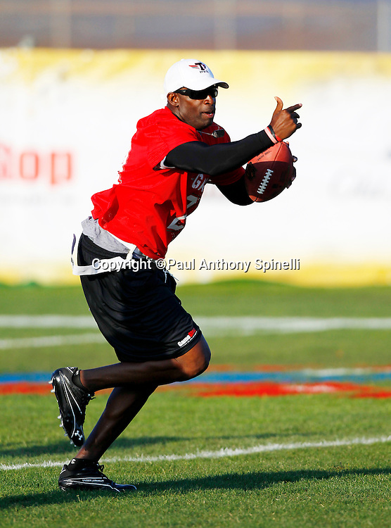 Former Dallas Cowboys cornerback Deion Sanders (21) of the Gamers team runs the ball while playing flag football in the EA Sports Madden NFL 11 Launch celebrity and NFL player flag football game held at Malibu Bluffs State Park on July 22, 2010 in Malibu, California. (©Paul Anthony Spinelli)