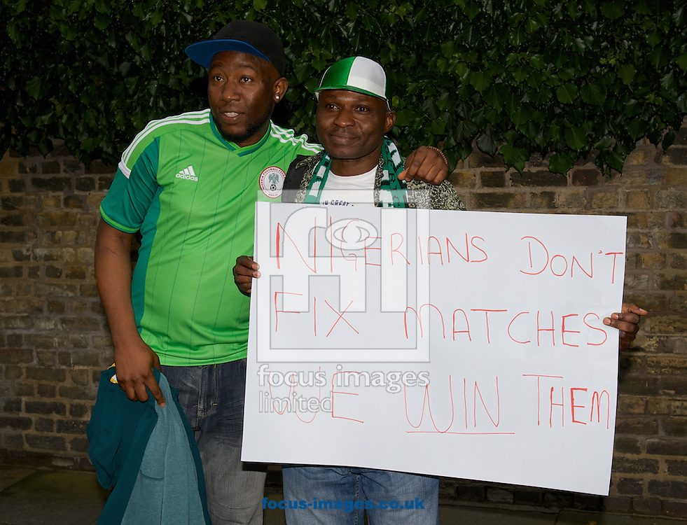 Nigerian fans with a banner relating to the match fixing before the International Friendly match at Craven Cottage, London<br /> Picture by Alan Stanford/Focus Images Ltd +44 7915 056117<br /> 28/05/2014