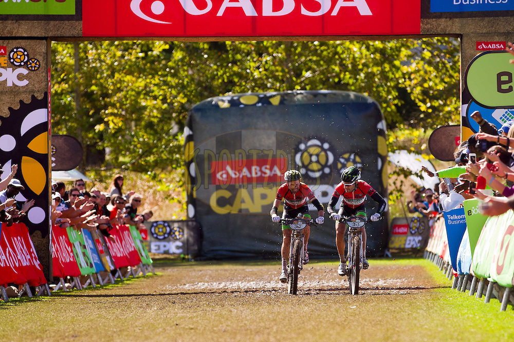 Stage winners and second overall team 360Life, David George and Kevin Evans cross the finish line during stage 6 of the 2012 Absa Cape Epic Mountain Bike stage race held in and around Oak Valley Wine Estate in the Elgin Valley, South Africa on the 31 March 2012..Photo by Sven Martin/Cape Epic/SPORTZPICS