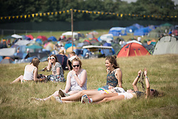 Image ©Licensed to i-Images Picture Agency. 18/07/2014  Henham Park , Suffolk, United Kingdom. Festival goers arrive at Henham Park on what is forecast to be the hottest day of the year so far with temperatures due to hit 30 degrees centigrade. The Latitude Festival of music and arts. Picture by Joel Goodman / i-Images