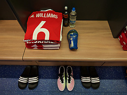 CARDIFF, WALES - Thursday, March 24, 2016: The shirt and boots of Wales' captain Ashley Williams in the dressing room before the International Friendly match against Northern Ireland at the Cardiff City Stadium. (Pic by David Rawcliffe/Propaganda)