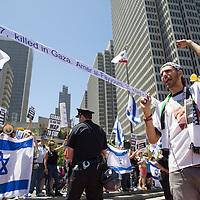Following news of the Israeli ground invasion of Gaza, proponents of Palestine chant in opposition to the , while pro-Israel demonstraters stage a counter movement at Justin Herman Plaza in San Francisco, CA July 27,2014.  Members of the San Francisco Police Department created a barricade between the two groups gathered.