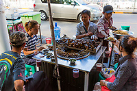 YANGON, MYANMAR -NOVEMBER 25, 2016 : people eating  street food at Yangon (Rangoon) in Myanmar (Burma)