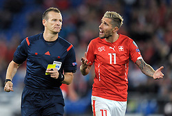 05.09.2015, St. Jakob Park, Basel, SUI, UEFA Euro 2016 Qualifikation, Schweiz vs Slowenien, Gruppe E, im Bild Valon Behrami (SUI) talks to referee Pavel Kralovec // during the UEFA EURO 2016 qualifier group E match between Switzerland and Slovenia at the St. Jakob Park in Basel, Switzerland on 2015/09/05. EXPA Pictures © 2015, PhotoCredit: EXPA/ Freshfocus/ Steffen Schmidt<br /> <br /> *****ATTENTION - for AUT, SLO, CRO, SRB, BIH, MAZ only*****