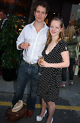 CHRISPIAN CUSS and LEONORA GUMMER at a party to celebrate the re-launh of Penhaligon's at 132 Kings Road, London SW3 on 7th June 2006.<br /><br />NON EXCLUSIVE - WORLD RIGHTS