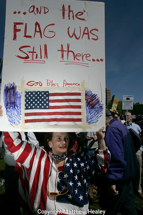 A Tea Party supporters waves a sign during a a Tea Party Express rally featuring Sarah Palin on Boston Common in Boston, Massachusetts on Wednesday, April 14, 2010.     Photo by Matthew Healey