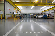 Painted walkways indicate safe routes through the facility at Exelis Inc. in Rochester, New York on September 10, 2014. Exelis is an aerospace and defense company, and employs numerous former Kodak workers in its Rochester facility.