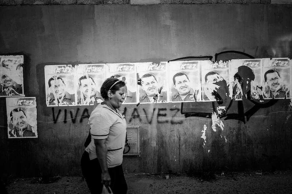Hugo Chavez campaign posters line the street outside of Sarria nucleo, of the El Sistema music program in Sarria, a  dangerous slum in Caracas, Venezuela.