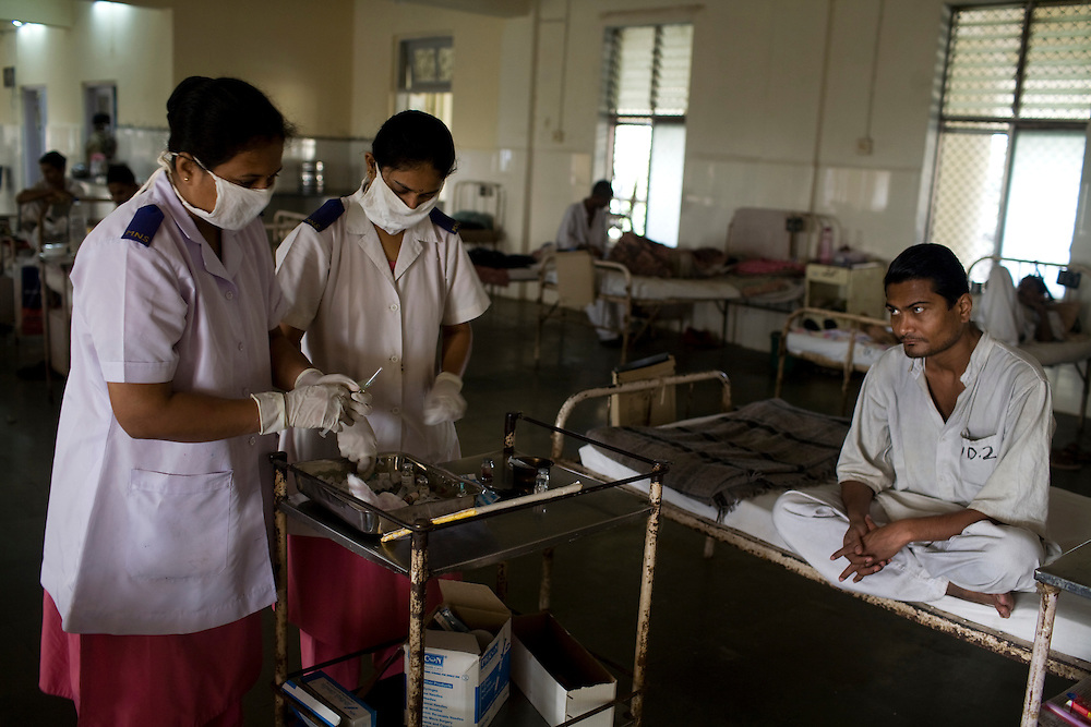 Nurses prepare an injection for a patient at the Group of TB Hospitals in Mumbai, India.