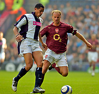 Photo: Leigh Quinnell.<br /> West Bromwich Albion v Arsenal. The Barclays Premiership.<br /> 15/10/2005. Arsenals Dennis Bergkamp closes in on West Broms Curtis Davis.