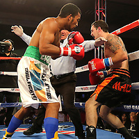 ORLANDO, FL - OCTOBER 04: Esquiva Falcao, 2012 Olympic silver medalist from Brazil (L), punches Austin Marcum as the referee halts the bout, during a professional boxing match at the Bahía Shriners Auditorium & Events Center on October 4, 2014 in Orlando, Florida. Falcao won the fight on a stoppage. (Photo by Alex Menendez/Getty Images) *** Local Caption *** Esquiva Falcao; Austin Marcum