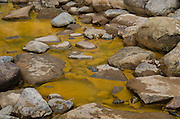 Sediment from toxic wastewater collects along the shallows of the Animas River at Santa Rita Park in Durango, Colorado following the Gold King Mine spill.