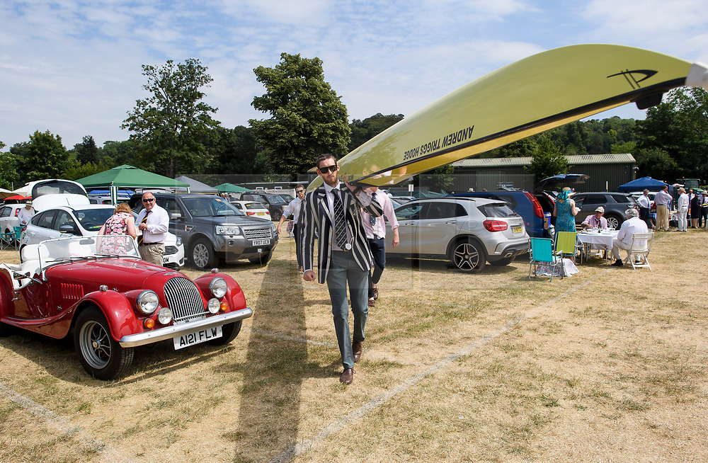 © Licensed to London News Pictures. 04/07/2018. Henley-on-Thames, UK. Rowers form Oxford University Lightweight Rowing Club carry their boat through the car park on Day one of the Henley Royal Regatta, set on the River Thames by the town of Henley-on-Thames in England. Established in 1839, the five day international rowing event, raced over a course of 2,112 meters (1 mile 550 yards), is considered an important part of the English social season. Photo credit: Ben Cawthra/LNP