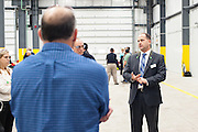 Valley Electrical employee briefing grand opening attendess before touring the facility.