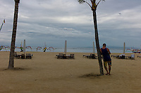 Tourist on the beach at Sanur. Bali revisited January 2012.