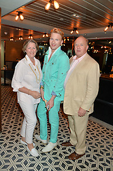 HENRY CONWAY and his parents DEREK & COLLETTE CONWAY at Henry Conway's 31st birthday party held at the Pont St Restaurant, Belgraves Hotel, London on 12th July 2014.
