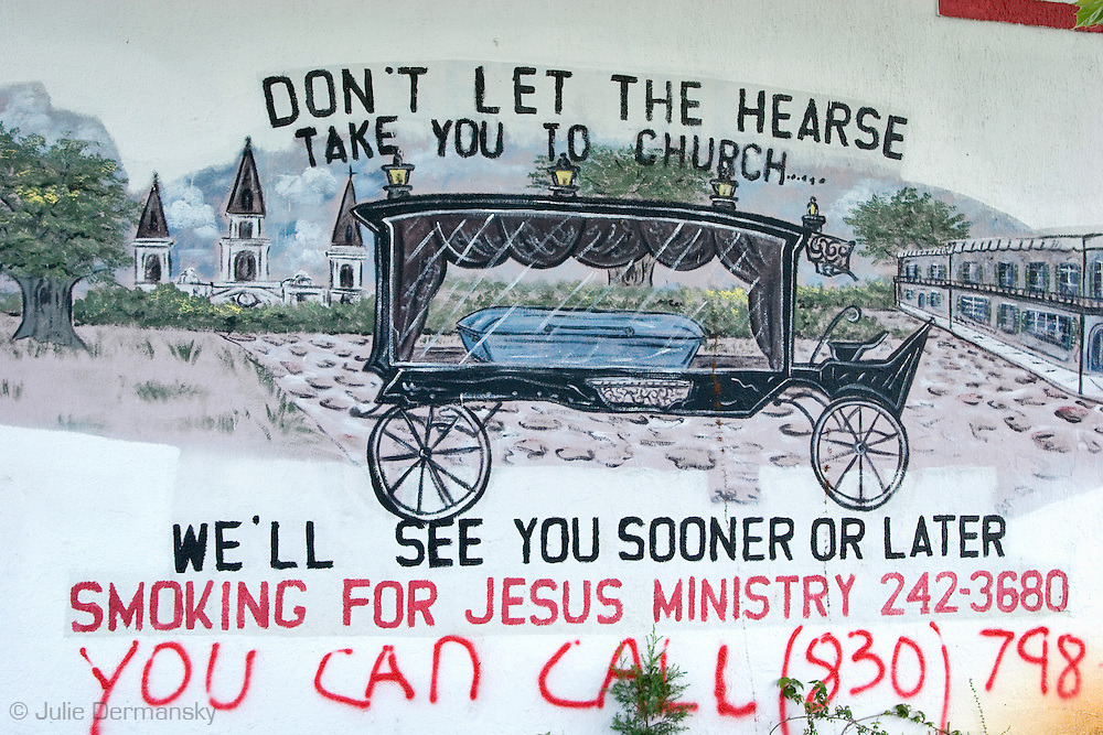 Hand pained sign on  a funeral home in New Orleans east destoyed by Hurricane Katirna,