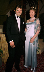 LORD PORCHESTER, son and heir of the Earl of Carnarvon, and MISS FIONA AITKEN, at a ball in London on 22nd May 1997.LYO 34