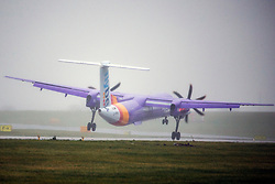 © Licensed to London News Pictures. 28/11/2018. Leeds UK. A Flybe aircraft struggles to land in strong winds at Englands highest airport, Leeds Bradford International as storm Diana begins to hit parts of the UK. Photo credit: Andrew McCaren/LNP