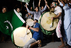 June 18, 2017 - Hyderabad, Sindh, Pakistan - Cricket lovers  drums in there hand performing dance on the traditional beat after the match wins by the Pakistani team against India in champions trophy on June 18. (Credit Image: © Janali Laghari/Pacific Press via ZUMA Wire)