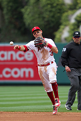 May 20, 2018 - Anaheim, CA, U.S. - ANAHEIM, CA - MAY 20: Ian Kinsler (3) of the Angels tosses the ball over to first base for the out during the major league baseball game between the Tampa Bay Rays and the Los Angeles Angels on May 20, 2018 at Angel Stadium of Anaheim in Anaheim, California. (Photo by Cliff Welch/Icon Sportswire) (Credit Image: © Cliff Welch/Icon SMI via ZUMA Press)