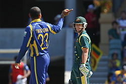 © Licensed to London News Pictures. 08/03/2012. Adelaide Oval, Australia. Sri Lankan bowler Tillakaratne Dilshan has a argument with Australian Batsmen .Matthew Wade and points towards the dressing room during the One Day International cricket match final between Australia Vs Sri Lanka. Photo credit : Asanka Brendon Ratnayake/LNP