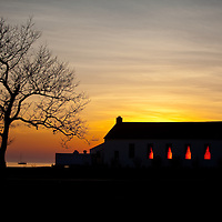 The setting sun's rays growl through the windows of the Sandy Hook Chapel, Sandy Hook New Jersey