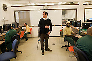 "Max Kenner in the computer room at Woodbourne Correctional Facility. Max is the brainchild behind the privately funded Bard College  Initiative for prison inmates...Story: The Bard Prison Initiative.Former inmate Carlos Rosario, 35-year-old husband and father of four, was released from Woodbourne Correctional Facility after serving more than 12 years for armed robbery. Rosado is one of the students participating in the Bard Prison Initiative, a privately-funded program that offers inmates at five New York State prisons the opportunity to work toward a college degree from Bard College. The program, which is the brainchild of alumnus Max Kenner, is competitive, accepting only 15 new students at each facility every other year. .Carlos Rosario received the Bachelor of Arts degree in social studies from the prestigious College Saturday, just a few days after his release. He had been working on it for the last six years. His senior thesis was titled ""The Diet of Punishment: Prison Food and Penal Practice in the Post-Rehabilitative Era,"".Rosado is credited with developing a garden in one of the few green spaces inside the otherwise cement-heavy prison. In the two years since the garden's foundation, it has provided some of the only access the prison's 800 inmates have to fresh vegetables and fruit...Rosario now works for a recycling company in Poughkeepsie, N.Y...Photo © Stefan Falke"