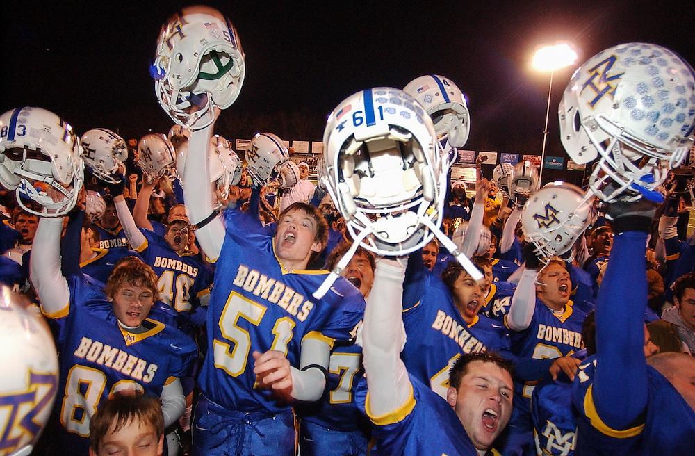 Mountain Home, Arkansas, High School football players celebrate a victory.